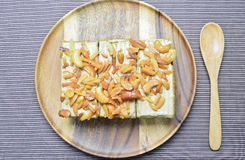 Peanut and cashew nut cake. On wooden plate Stock Images