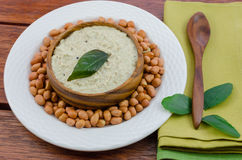Peanut chutney with a spoon Stock Image