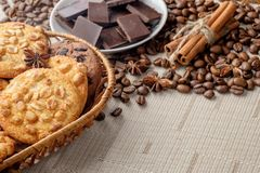 Peanut cookies and chocolate chips cookies in wicker basket. Royalty Free Stock Photography