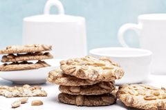 Peanut cookies in a light blue and white kitchen Royalty Free Stock Photography