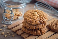 Peanut cookies on wooden plate Royalty Free Stock Photography