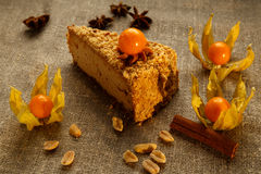 Peanut cream cheese cake with cape gooseberries. Royalty Free Stock Images