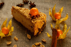 Peanut cream cheese cake with cape gooseberries. stock photography