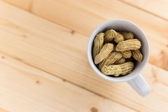 Peanut in Cup. On the table Royalty Free Stock Photos