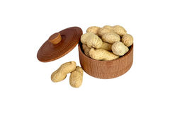 Peanut. Dried peanuts in wooden bowl Royalty Free Stock Images