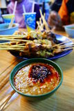 Peanut Gravy in Bowl and Plate full of Satay. Grilled chicken and beef satay with peanut gravy, one of malaysia's tradional food Stock Photos