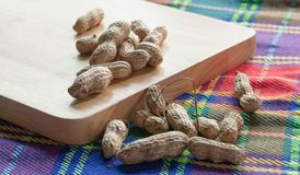 Peanut. Or groundnut on chopping block Stock Photography