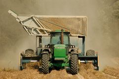 Peanut Harvest. Straight-on view of a tractor pulling a peanut combine Stock Photography