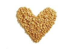 Peanut Heart. Healthy peanuts forming a heart shape stock images