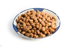 Peanut kernels. A plate of peanut kernels on white backround Royalty Free Stock Images