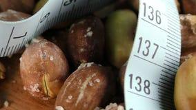 Peanut and Measurement Macro Viev. Video stock video footage