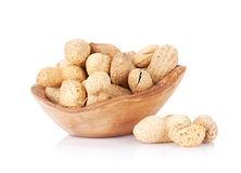 Peanut nuts. In bowl. Isolated on white background stock photos