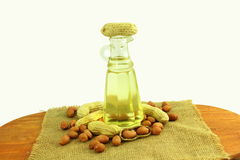 Peanut oil with peanuts whole and peeled Stock Photos