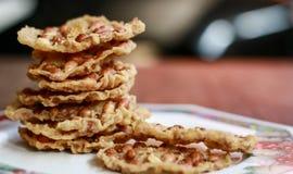 Rempeyek. Peanut Peyek on plate. Peanut Rempeyek or Peyek is a deep-fried savoury Javanese cracker made from  rice flour with peanut by crispy flour batter royalty free stock photo