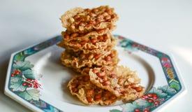 Rempeyek. Peanut Peyek on plate. Peanut Rempeyek or Peyek is a deep-fried savoury Javanese cracker made from  rice flour with peanut by crispy flour batter stock photos
