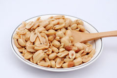 Peanut. A plate of delicious peanut on a white background Royalty Free Stock Images