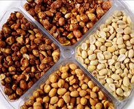 Peanut platter. Variety of different types of peanuts Royalty Free Stock Photo