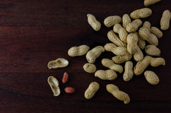 Peanut Shells on Dark Board Royalty Free Stock Photo