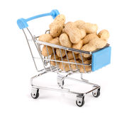 Peanut in a shopping cart isolated on white background Stock Image