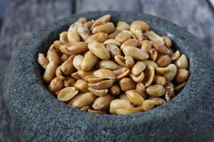 Peanut in a stone mortar Royalty Free Stock Image