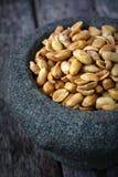 Peanut in a stone mortar Stock Image
