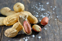Peanut on wooden background Royalty Free Stock Image