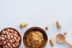 Peanut in wooden bowl on classic wooden table background, peanut butter. Copy space stock photo
