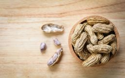 Peanut in wooden bowl wood background top view / Boiled peanuts stock images