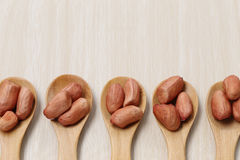 peanut in wooden spoon on wood background. Stock Photo