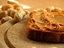 Peanutbutter sandwich. On wooden board royalty free stock photo