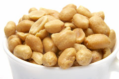 Peanuts 1. Close up of fried salted peanuts on white background Royalty Free Stock Images