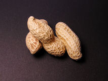 Peanuts. 3 peanuts over the black background Stock Images