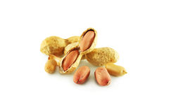 Peanuts. Peanut closeup, cleaned and with skin,  isolated Stock Images