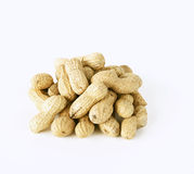 Peanuts. Heap of peanuts on white background Royalty Free Stock Photography
