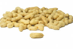 Peanuts. Over white background-selective focus on the front piece Stock Photo