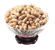 Peanuts. A bowl of peanuts on white background Stock Images