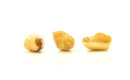 Peanuts. Closeup of three peanuts isolated on white studio background Stock Photo