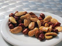 Peanuts and almonds. Close up view of some fried peanuts and almonds royalty free stock images