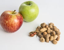 Peanuts and apple. Healthly concept isolated on white background Stock Photo