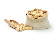 Peanuts in a bag and a scoop Stock Image