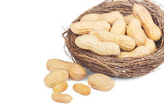 Peanuts in a basket isolated on white Royalty Free Stock Photos