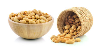 Peanuts in the basket and wood bowl Stock Image