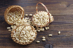 Peanuts in baskets Stock Photos