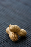 Peanuts on black, close-up Stock Photo