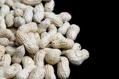 Peanuts on Black Stock Photo