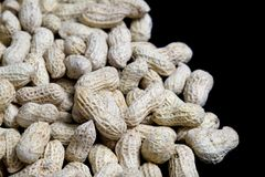 Peanuts on Black Royalty Free Stock Images