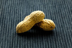 Peanuts. On a blue tablecloth Royalty Free Stock Image