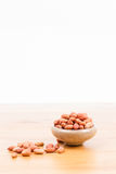 Peanuts in bowl Stock Image