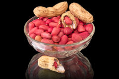 Peanuts in bowl on black Royalty Free Stock Photos