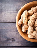 Peanuts in bowl Stock Photo